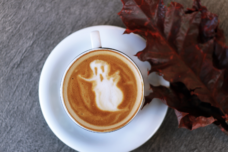 coffee with ghost and red leaf